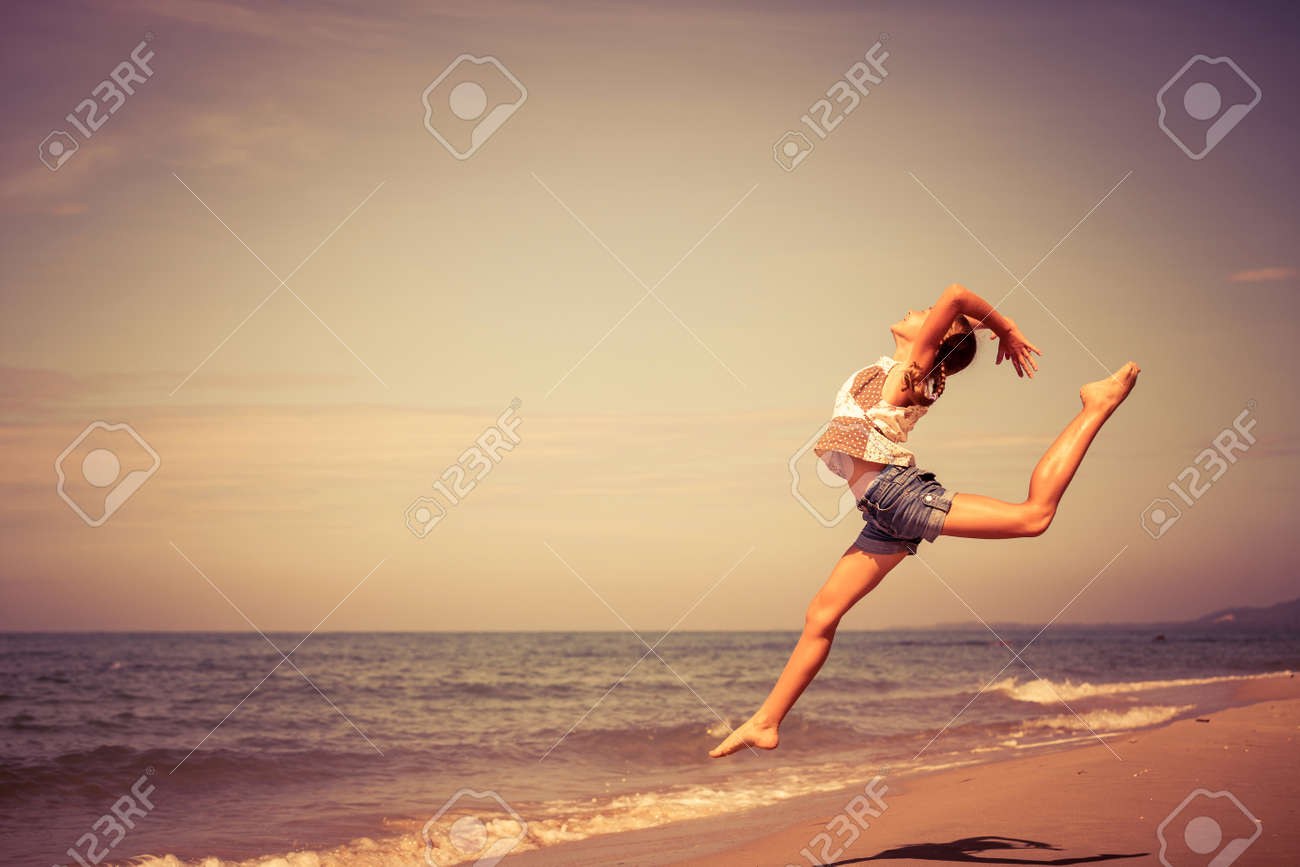 Teen  girl  jumping on the beach at the day time Stock Photo - 42099299