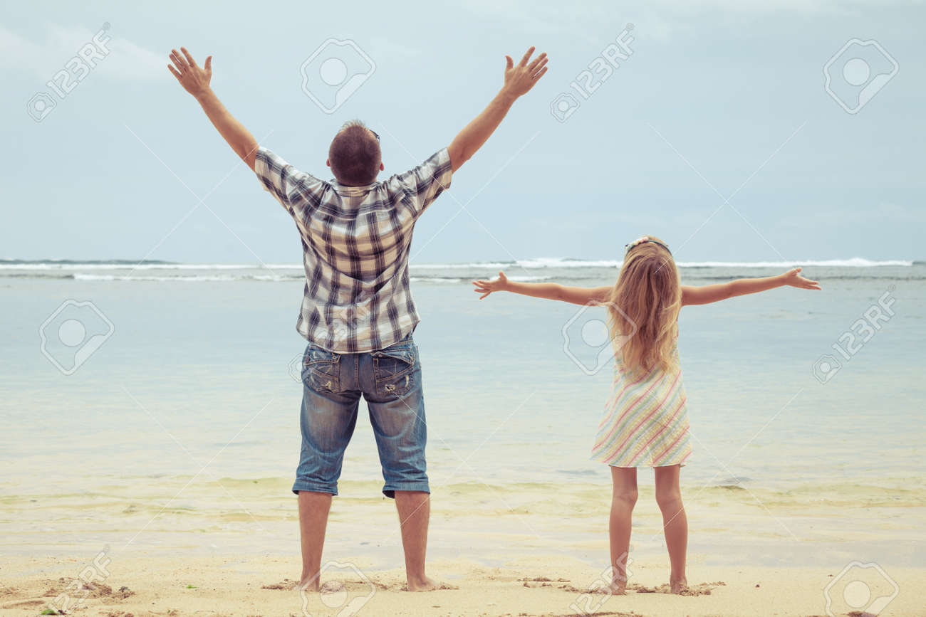 Father and daughter playing on the beach at the day time. Concept of friendly family. Stock Photo - 42157539