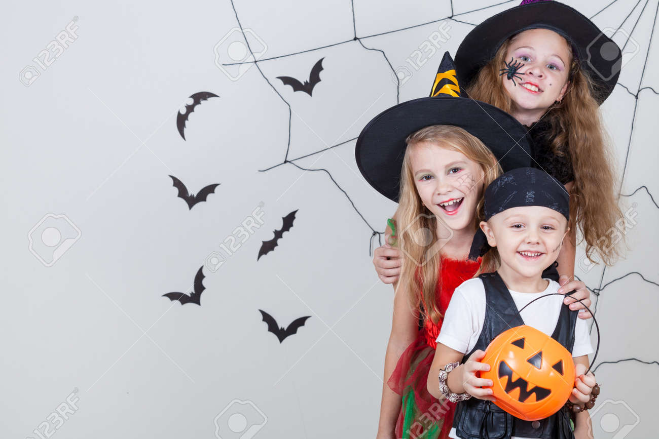 Happy brother and two sisters on Halloween party - 45244385