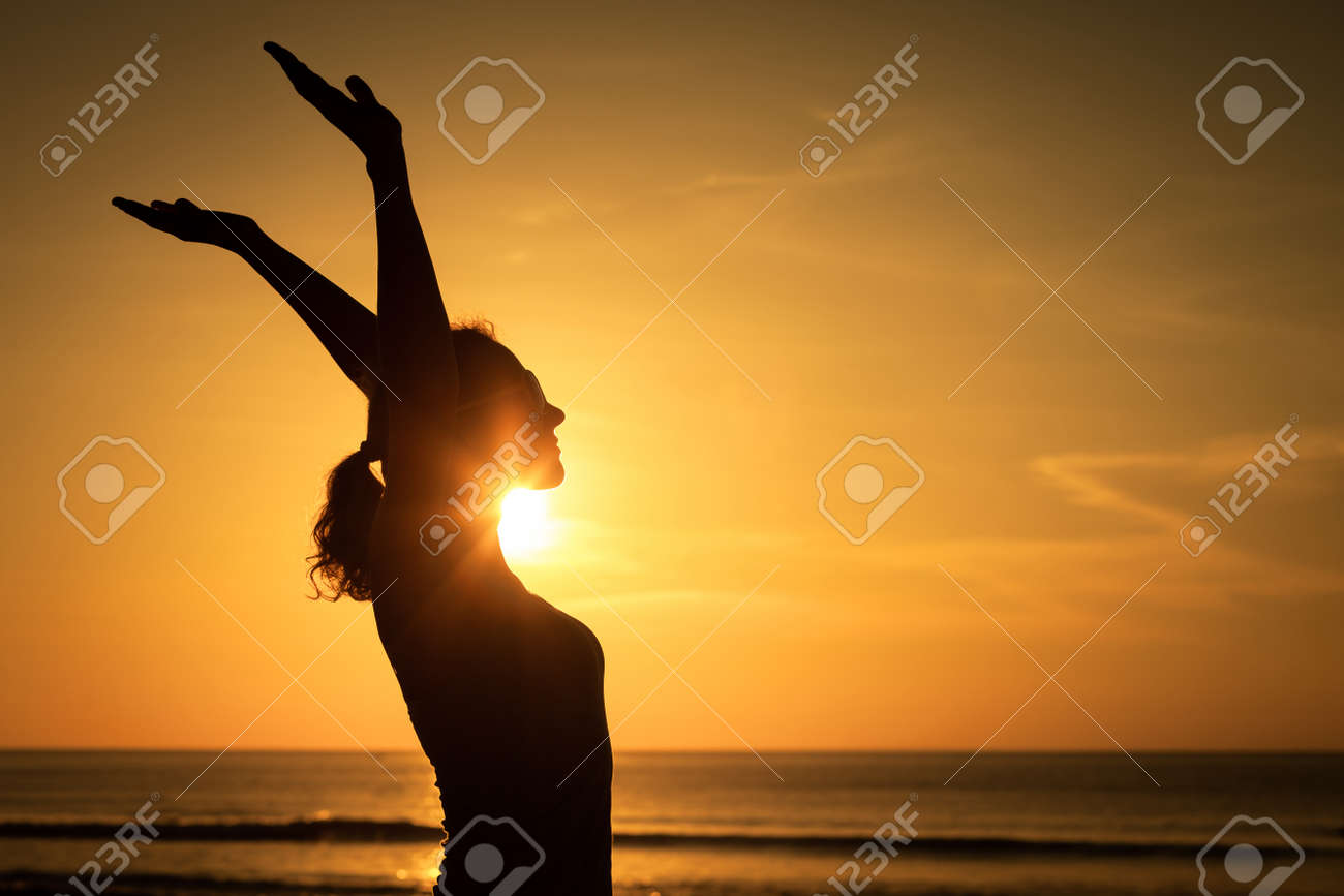 woman open arms under the sunset at sea. Concept of healthy life. Stock Photo - 47218555