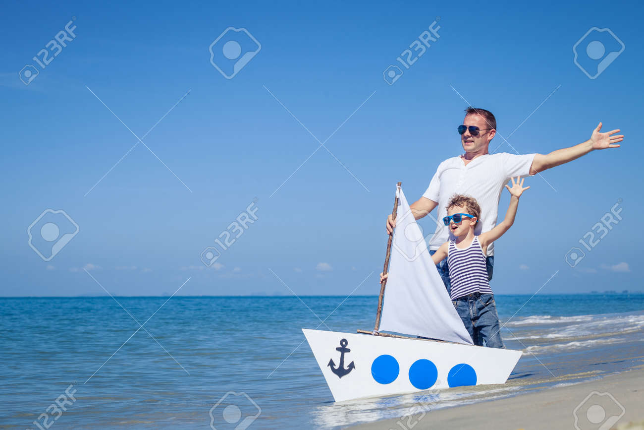 Father and son playing on the beach at the day time. Concept of friendly family. - 52668404