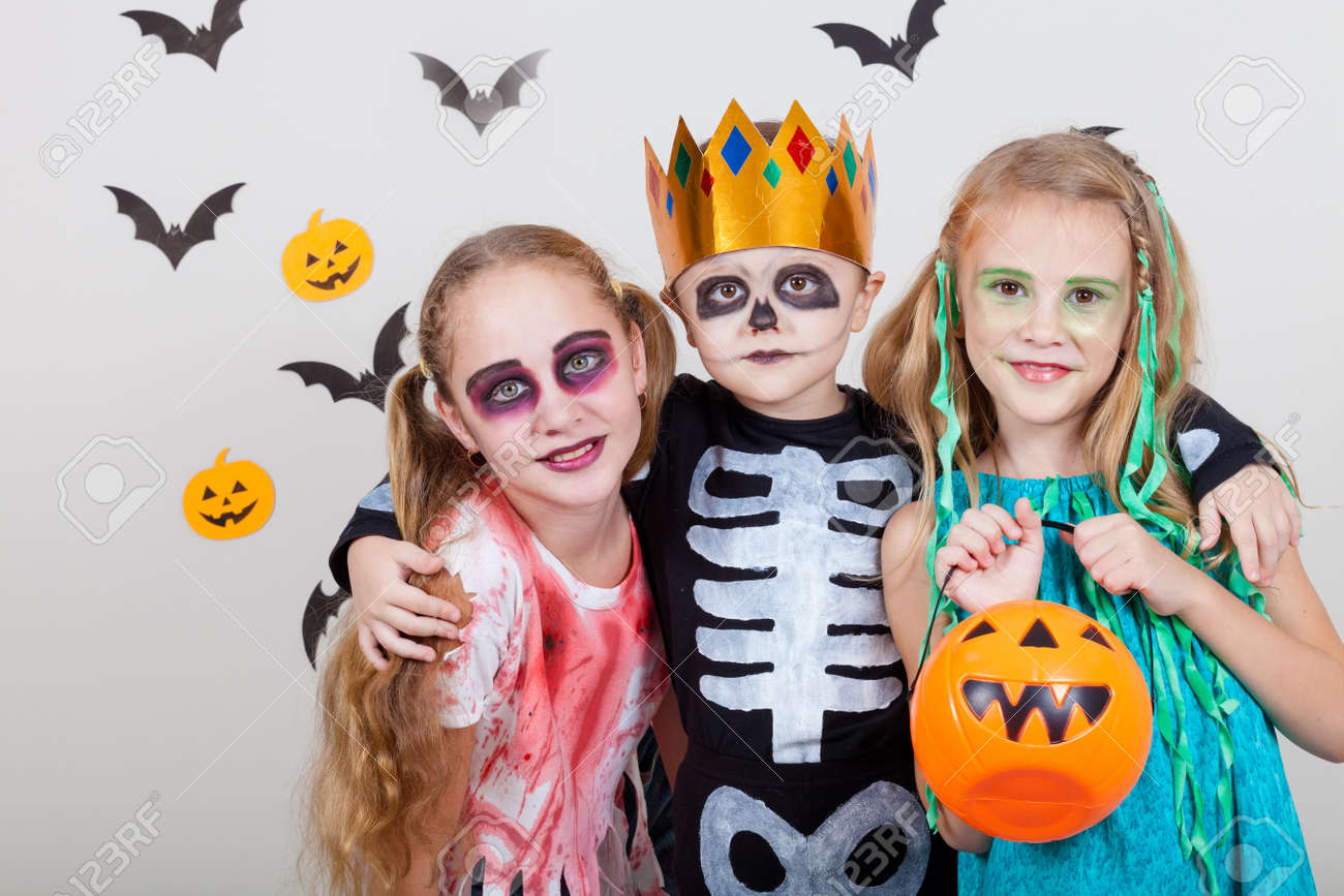 Happy Brother And Two Sisters On Halloween Party. People Having ...