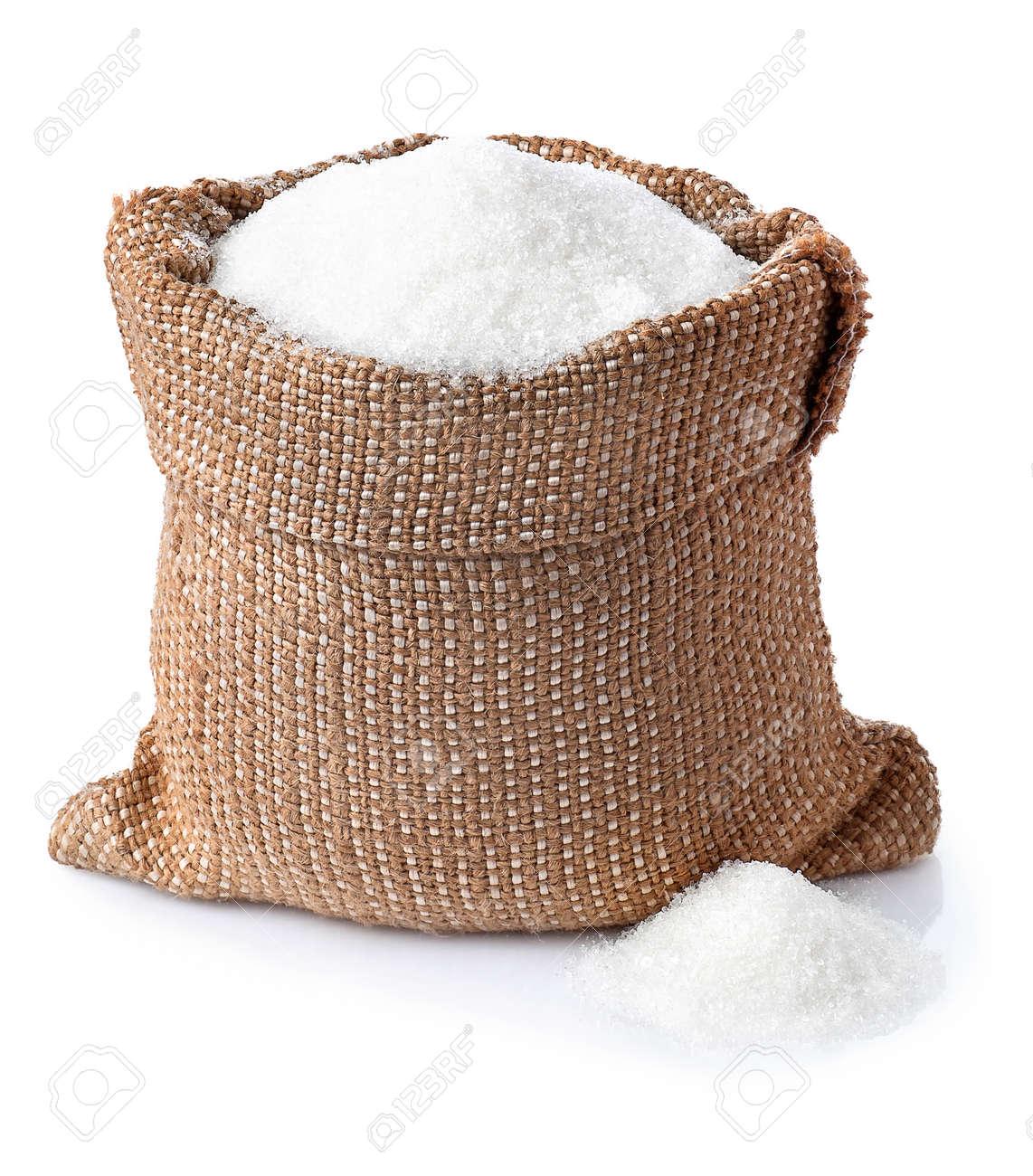 Sugar. Sugar in burlap sack isolated on white background. Full bag of sugar crystals closeup - 60398346