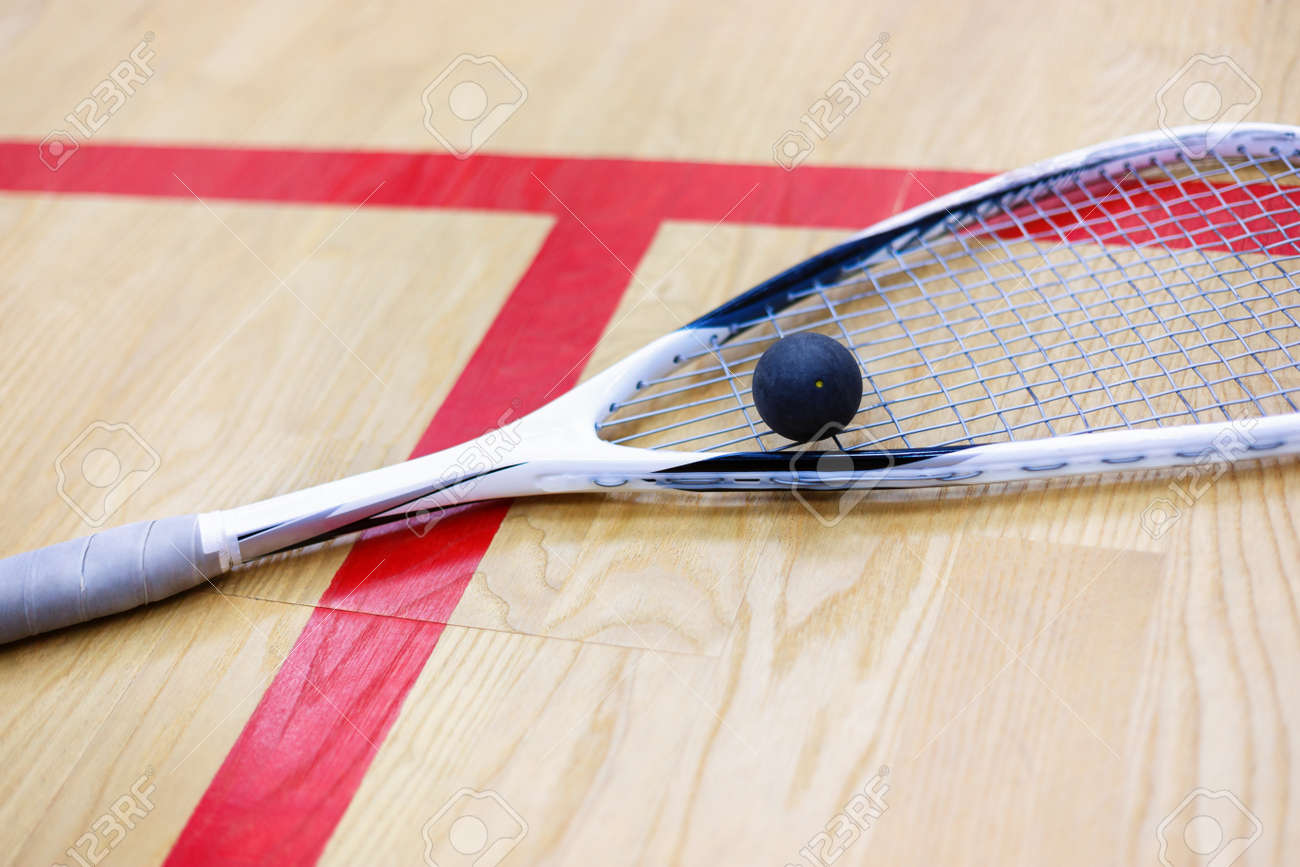 Squash Racket And Ball On The Wooden Background. Racquetball.. Stock Photo,  Picture And Royalty Free Image. Image 69761554.
