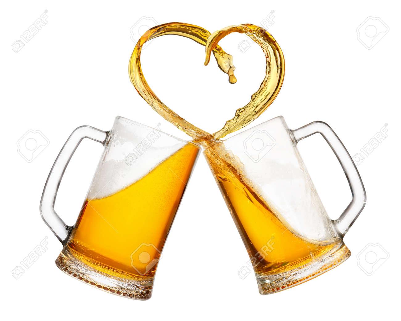 mugs of beer with splash - 94577278