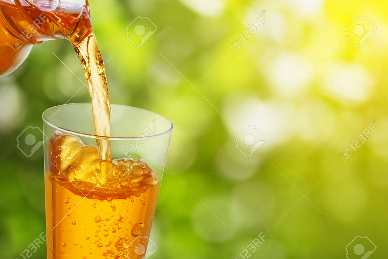 pouring apple juice - 97327427