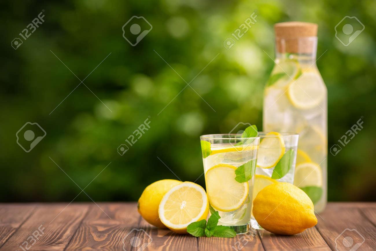 lemonade in glass and bottle - 124931844