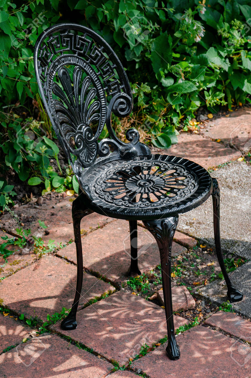 black wrought iron furniture. Stock Photo - Wrought Cast Iron Chair In The Garden Black Color Furniture T