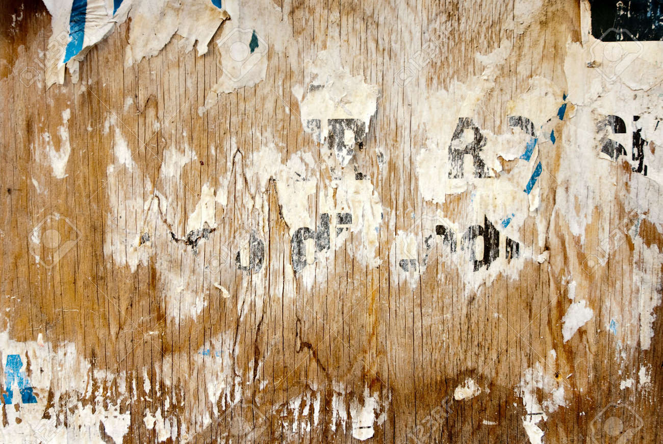 fragments of torn poster glued on wooden panel Stock Photo - 5062289