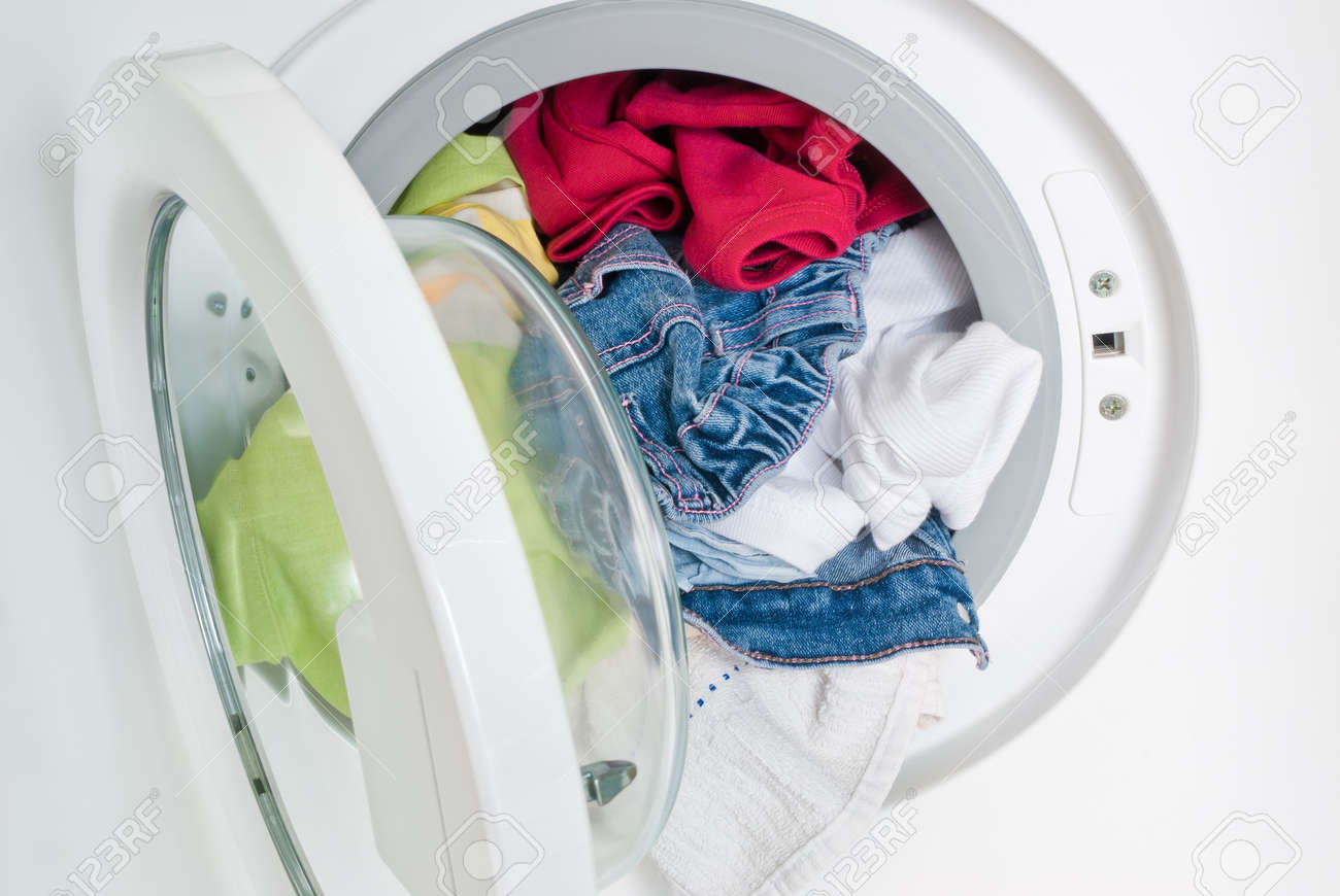 Washing Machine With Colorful Clothes Inside Stock Photo Picture