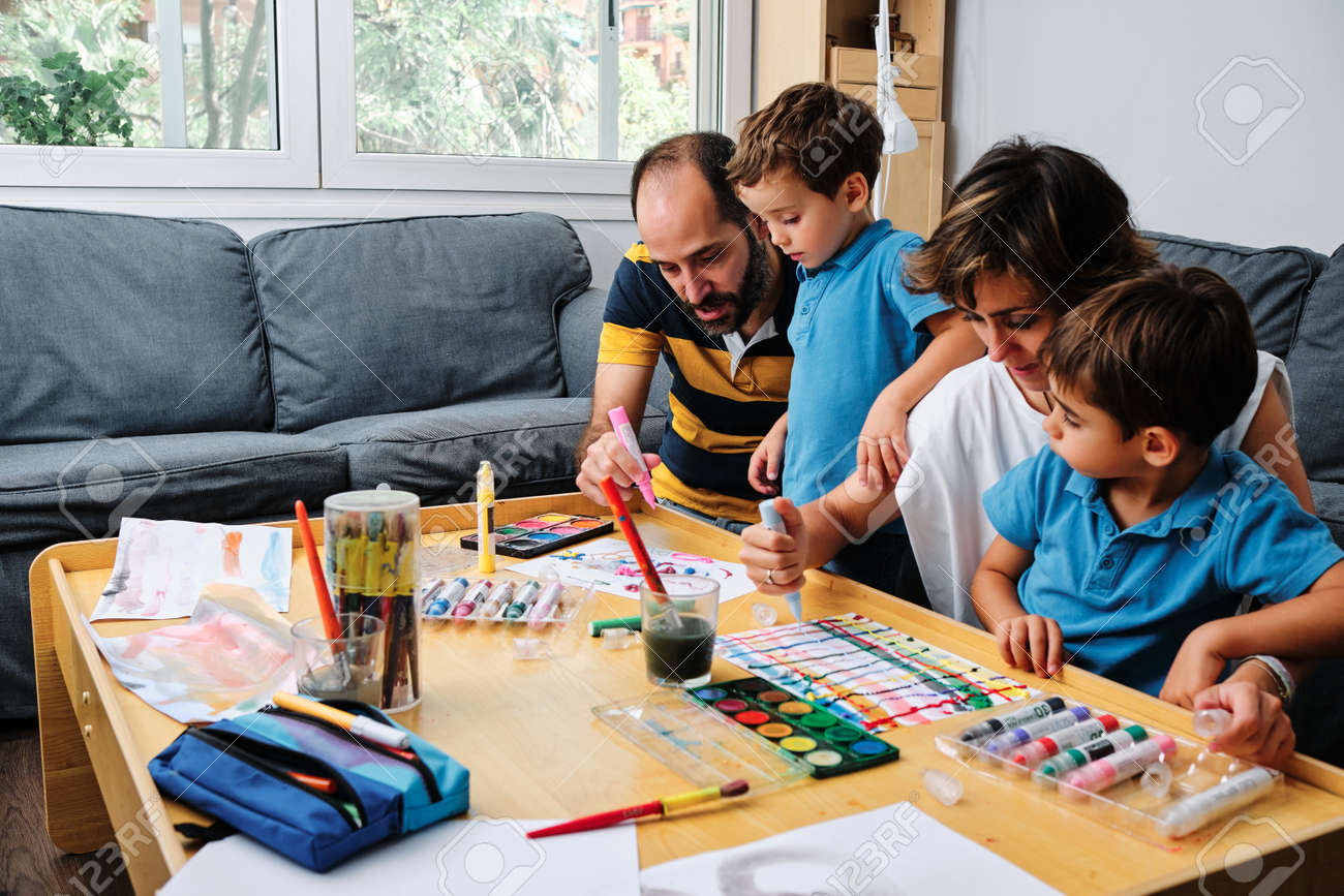 a family painting and playing with their kids - 155219818