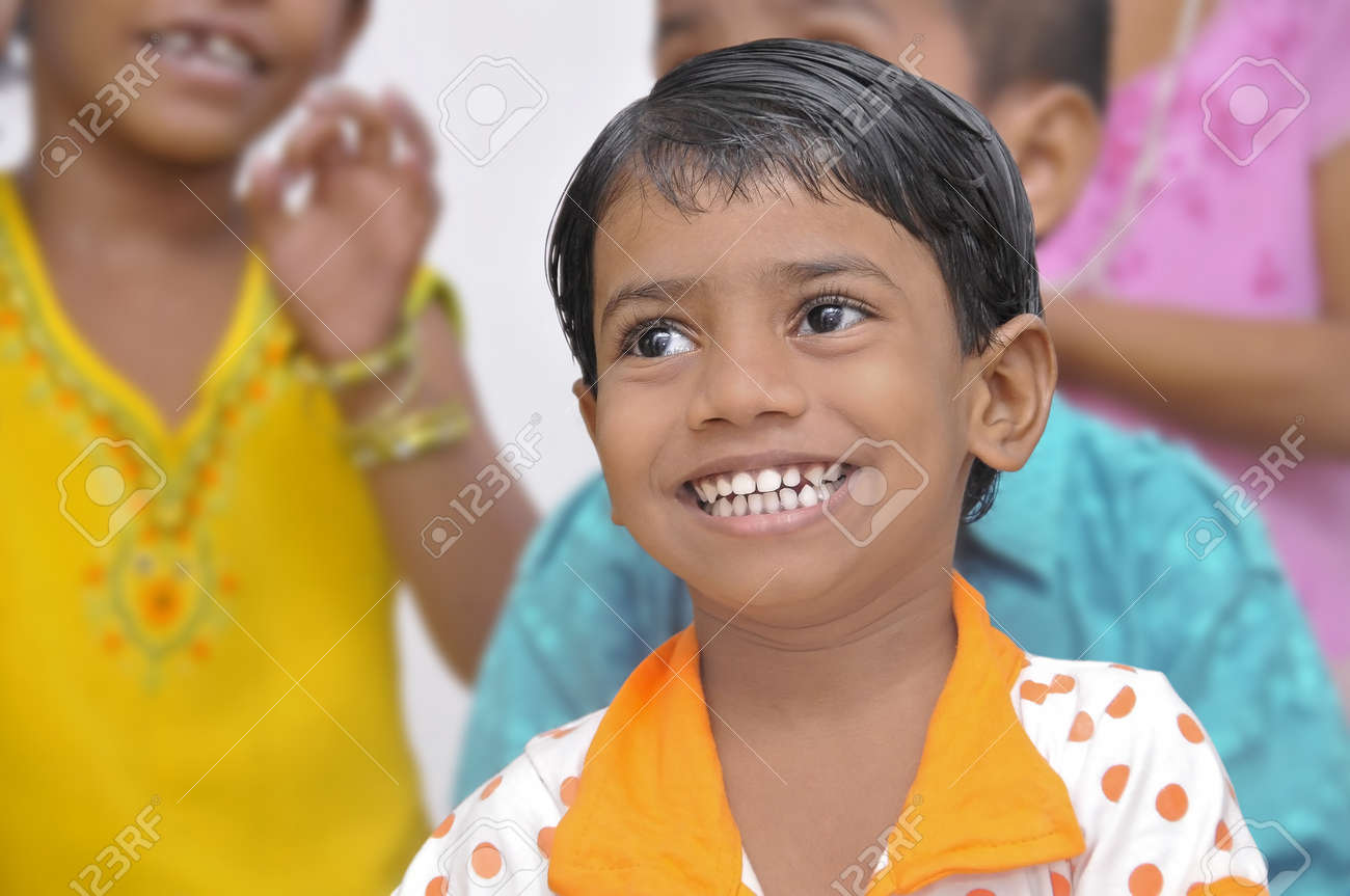 Several international organizations help to the children in the slums of Mumbai. In this photo, a girl smile in the class of one of these organizations in 20-10-2010. Stock Photo - 9205522