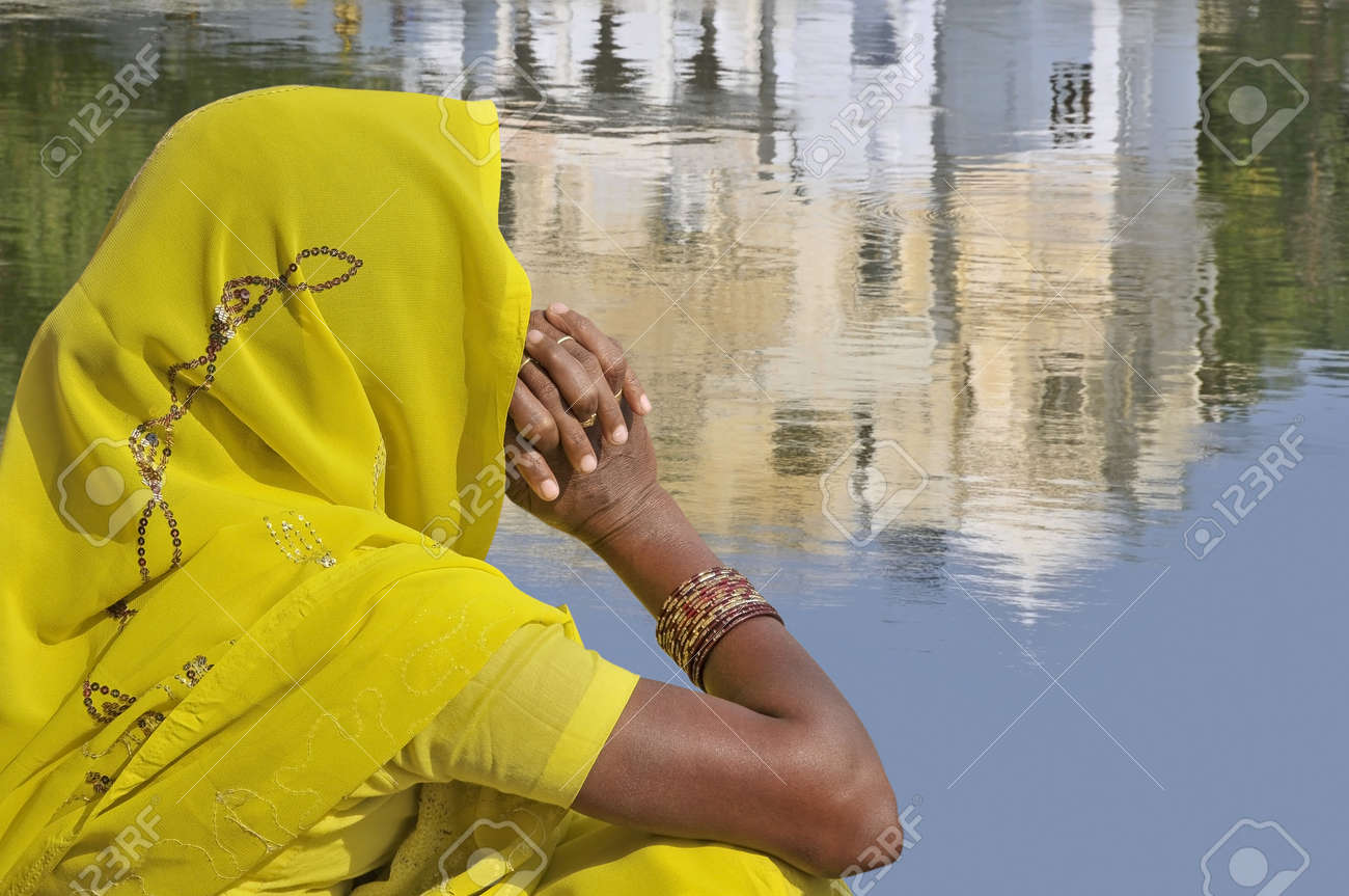 Woman with yellow sari in Rajasthan, India. Stock Photo - 9284452