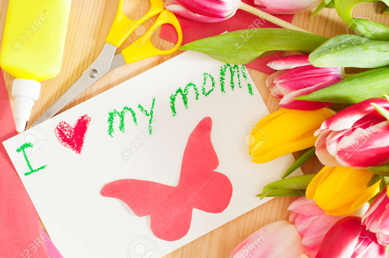 Bouquet Of The Tulips And Card With Greetings For Mother Stock Photo