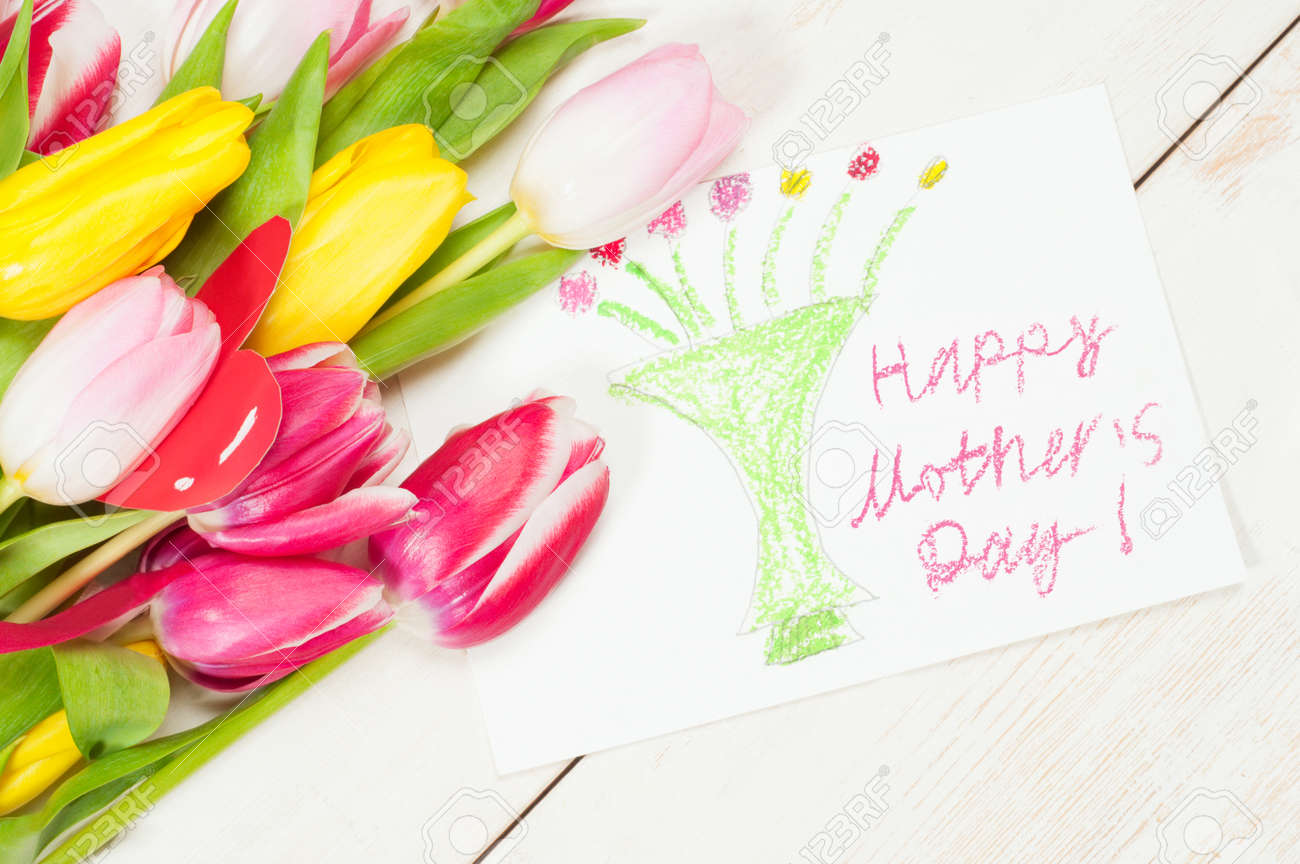 Bouquet Of Tulips And Kids Picture With Greetings For Mother Stock