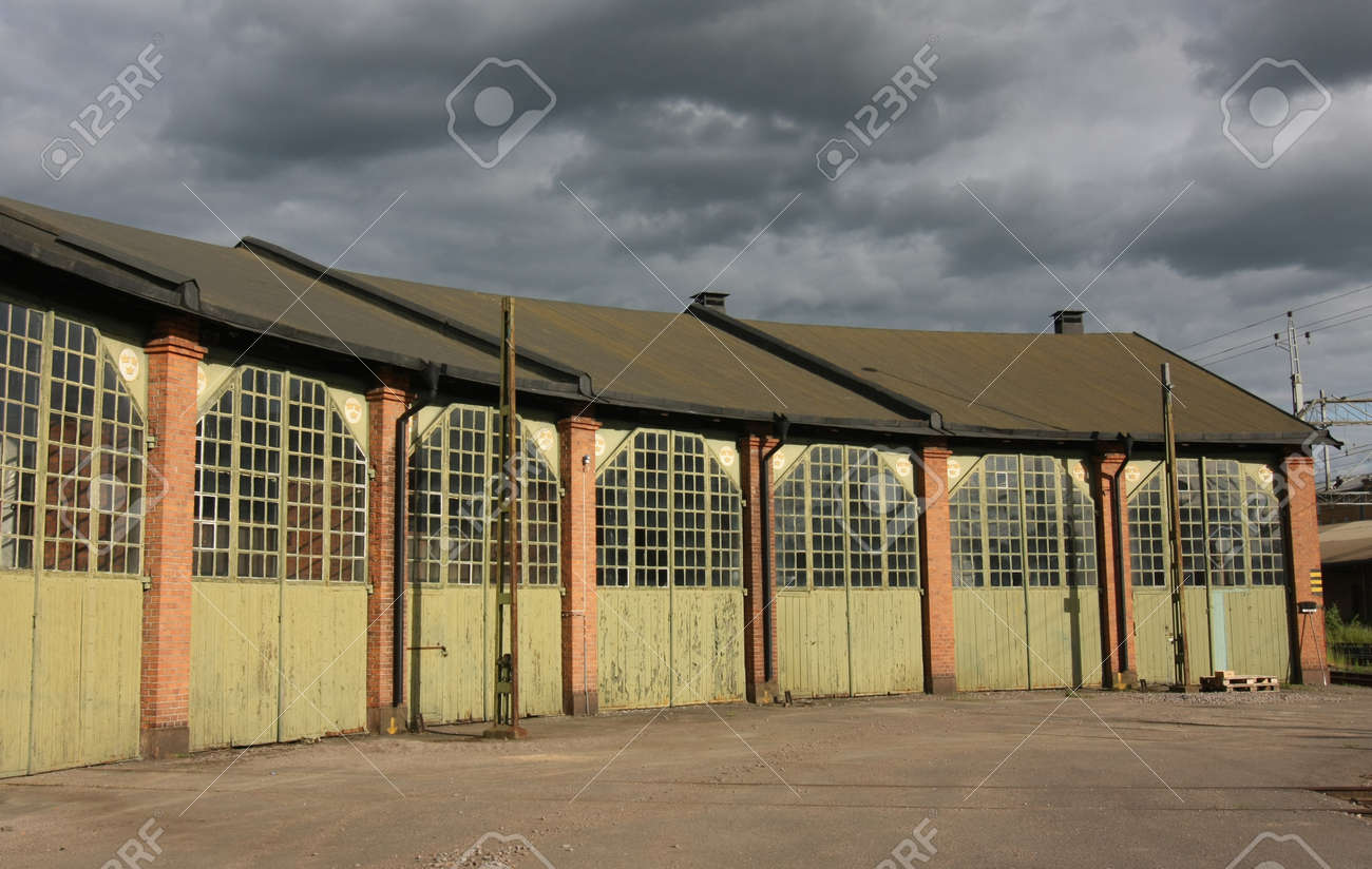 Old romantic storage building with huge doors and glass windows Stock Photo - 13875181