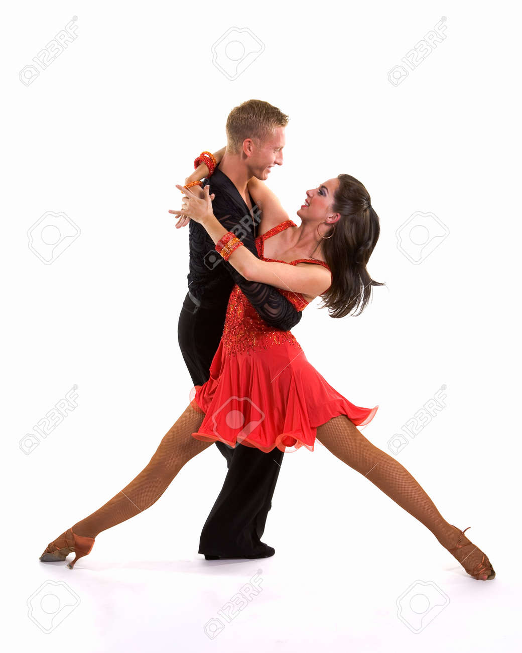 Young ballroom dancers in formal costumes posing against a solid background in a studio Stock Photo - 9621435