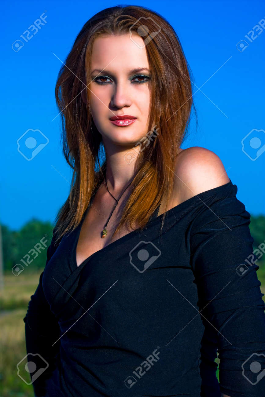 Portrait of a young red-haired woman Stock Photo - 5396428
