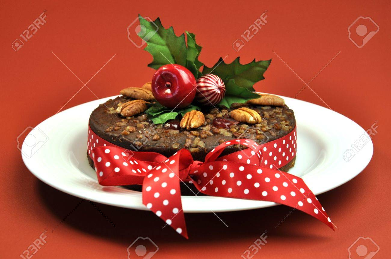 Christmas cake decoration with fruit and nuts - Christmas Fruit Cake Decorated With Nuts Holly And A Bright And Cheerful Red Polka Dot