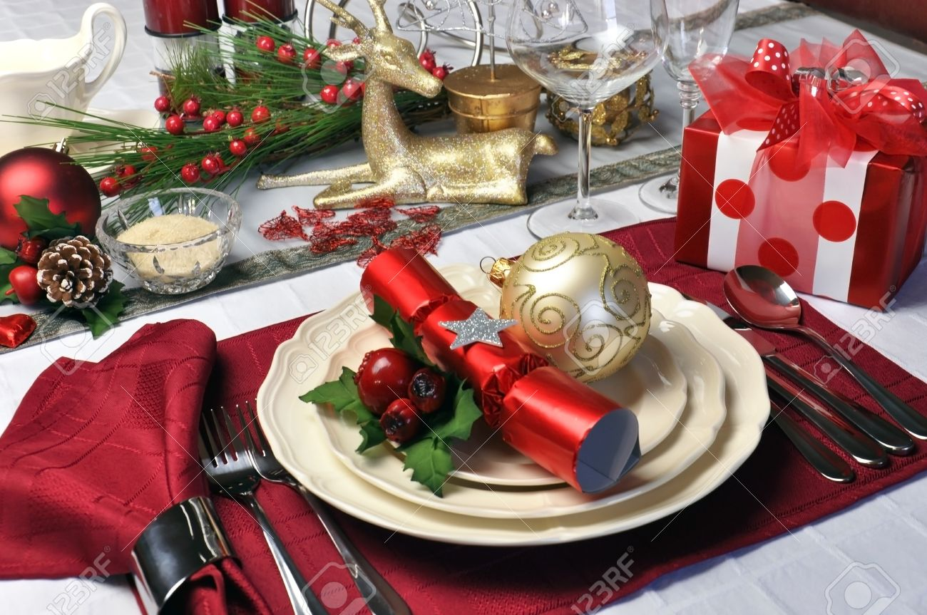 Modern and stylish Christmas dinner table setting including plates glasses and placemats bon bons & Modern And Stylish Christmas Dinner Table Setting Including Plates ...