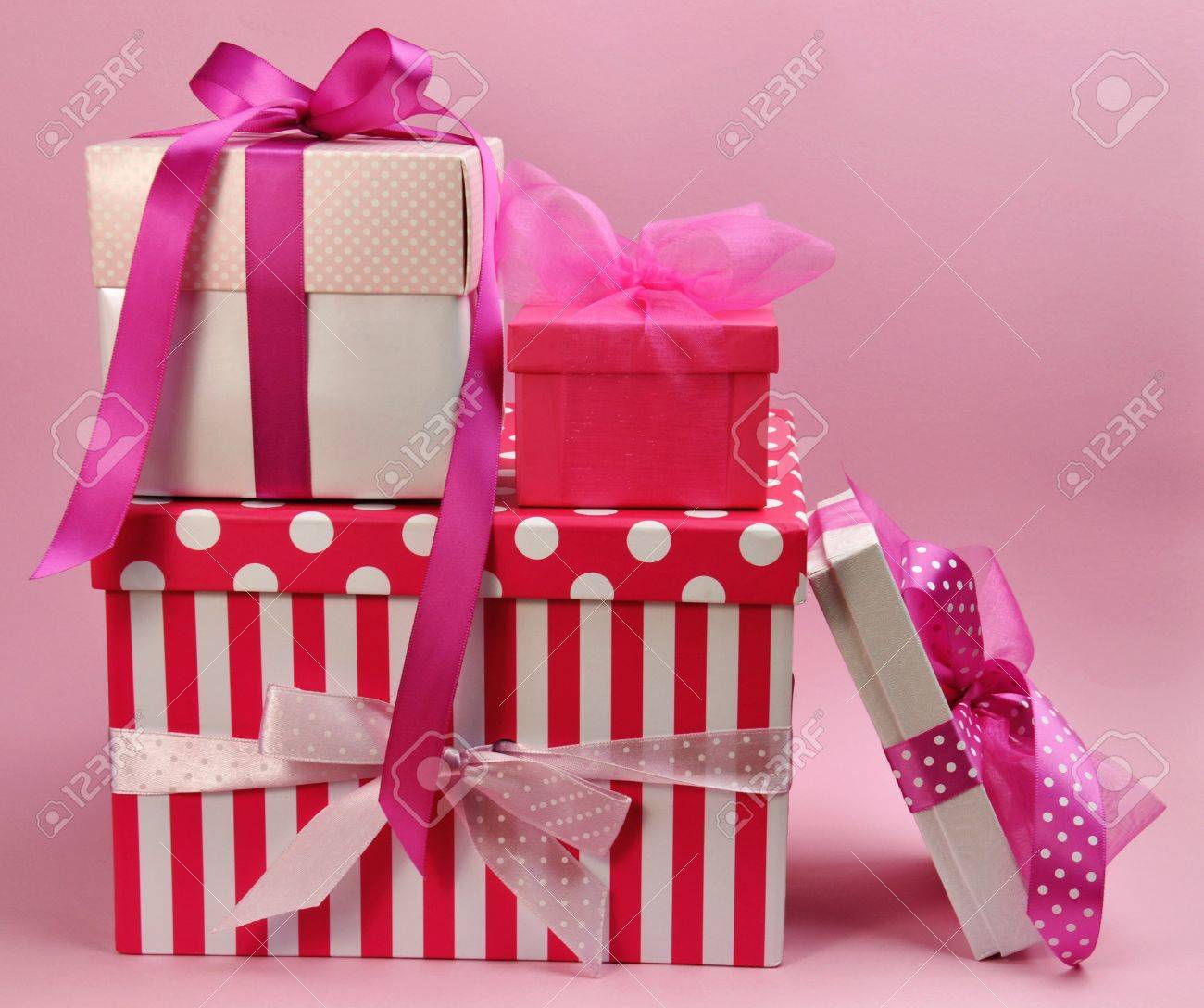 Stack Of Pretty Feminine Pink Presents And Gifts With Ribbons.. Stock Photo, Picture And Royalty Free Image. Image 16803358.