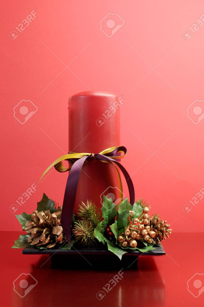 f91b7c303558 Red candle with holly and pine cone Christmas table centrepiece..