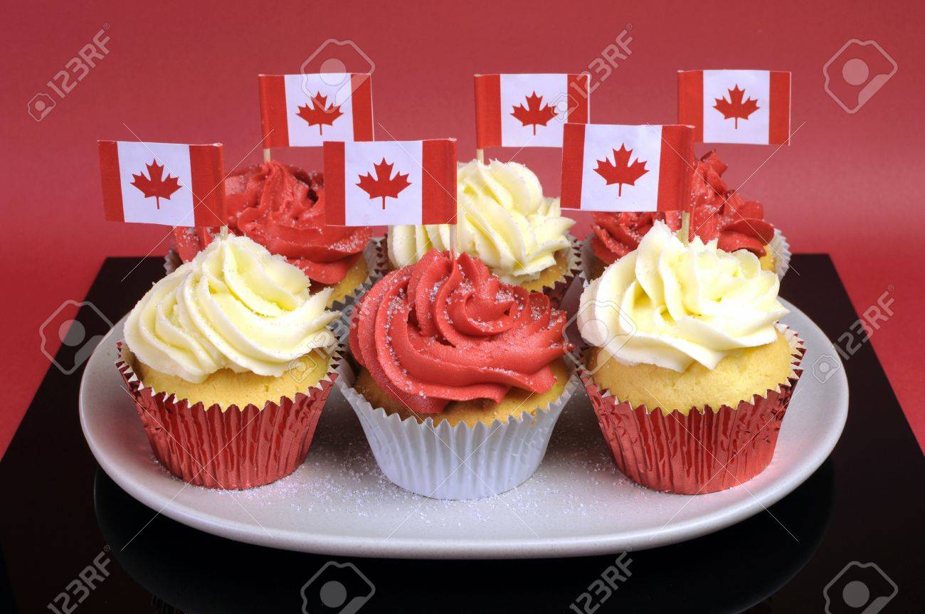 red and white cupcakes with canadian maple leaf national flags