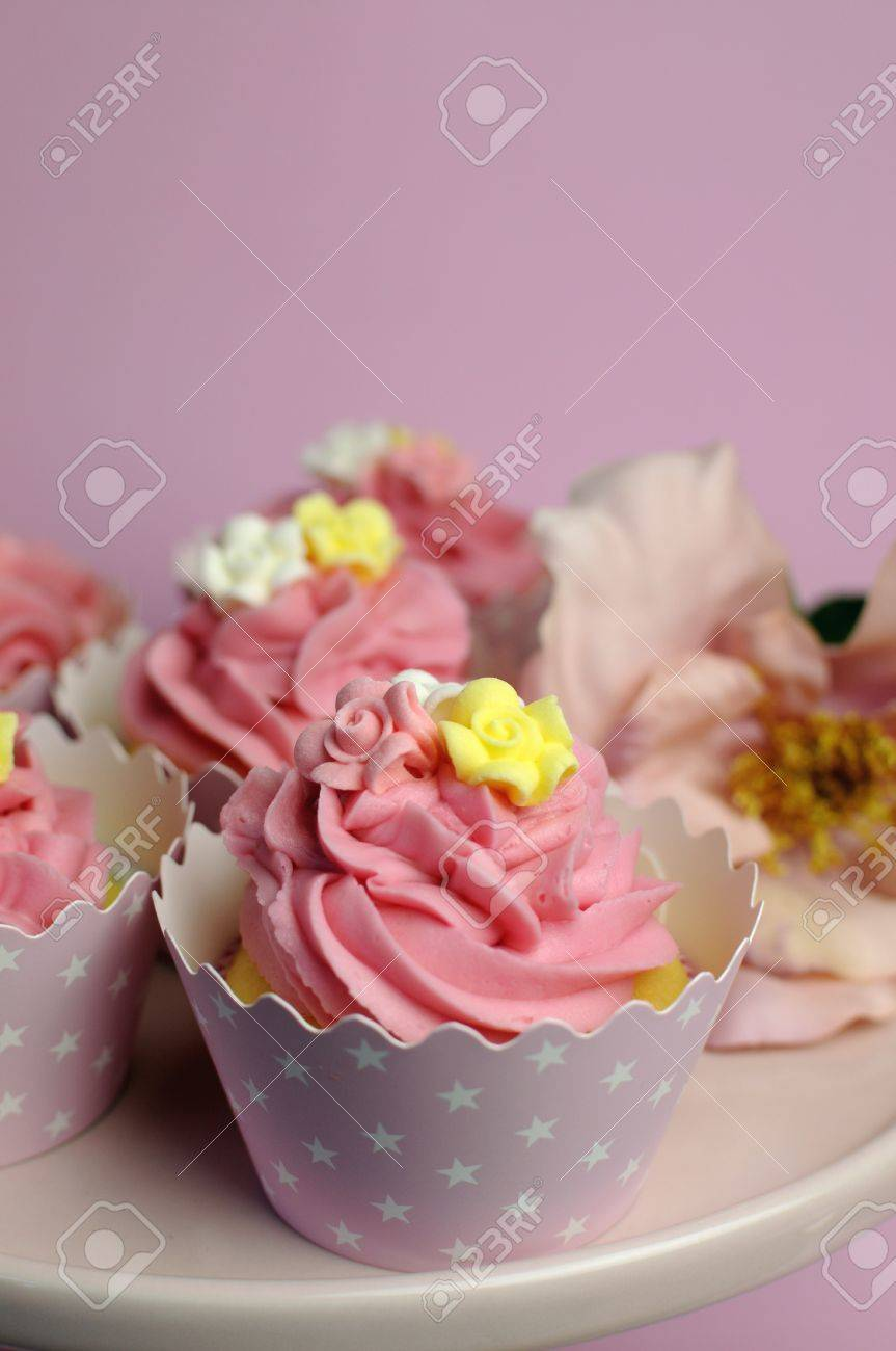Beautiful Pink Decorated Cupcakes On Pink Cake Stand For Birthday ...