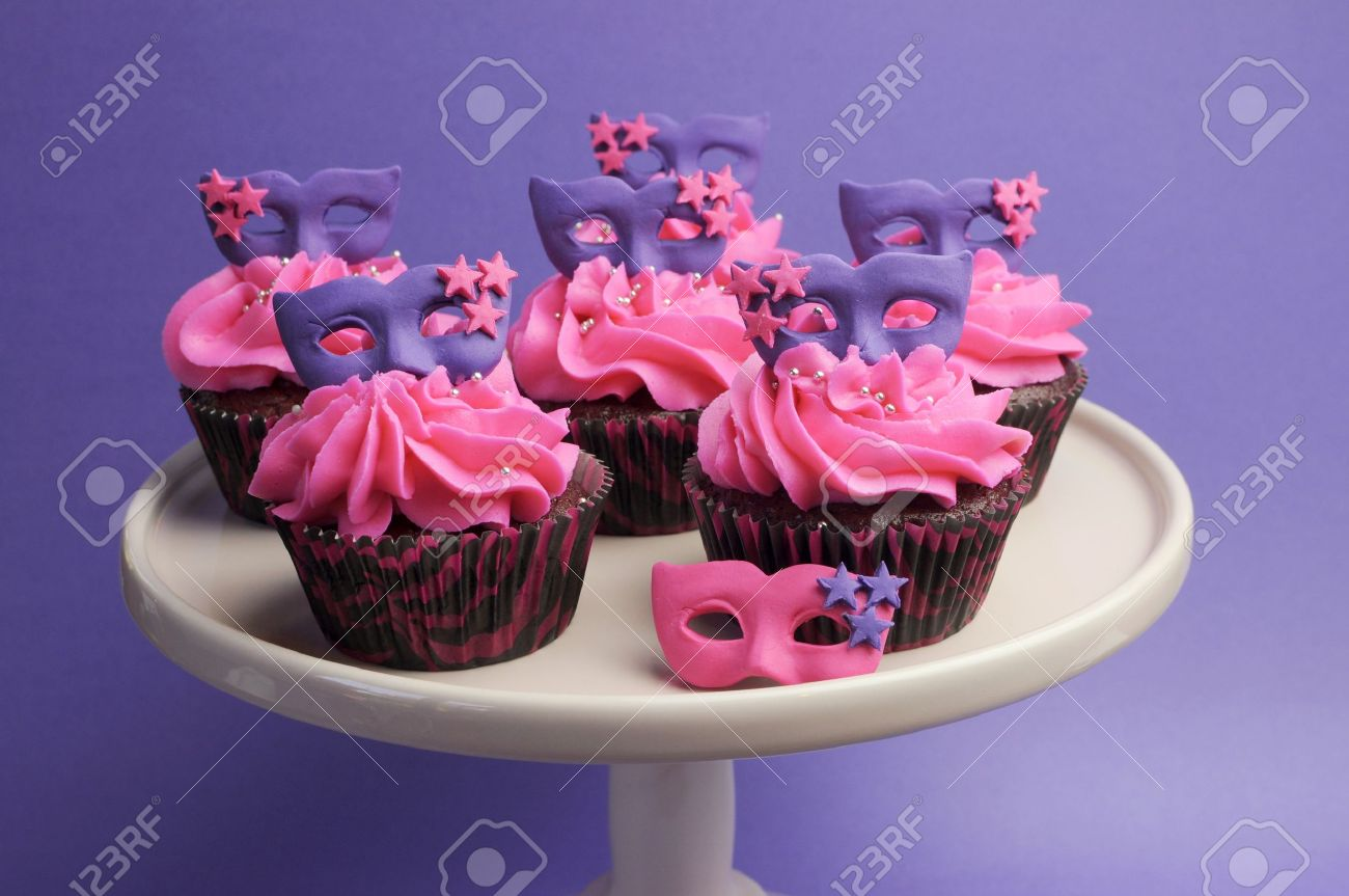 Pink And Purple Masquerade Masks Decorated Party Cupcakes With Frosting For Teenage Birthday