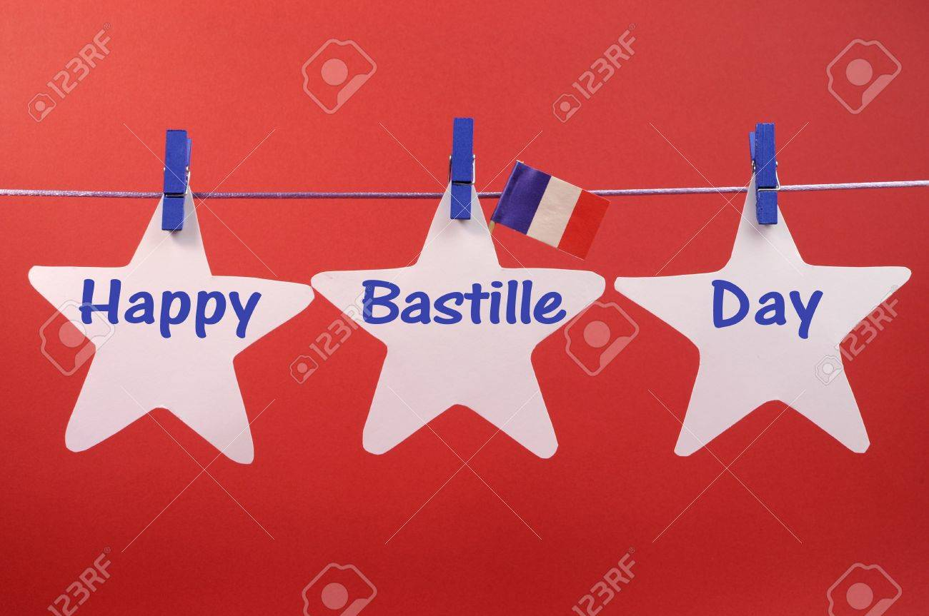 happy bastille day written across white stars hanging from pegs