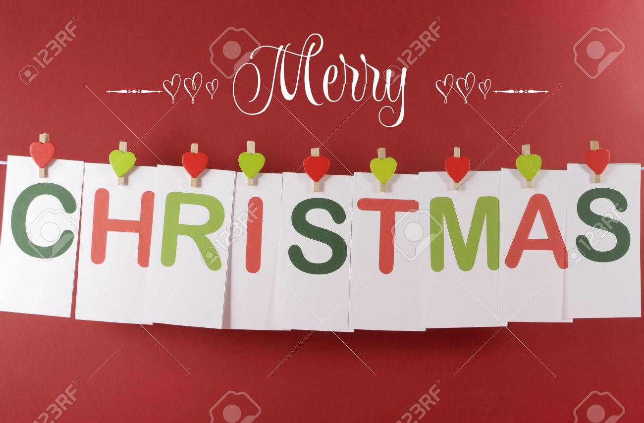 Merry christmas greeting message across red and green letter stock merry christmas greeting message across red and green letter cards hanging from heart shape pegs on m4hsunfo