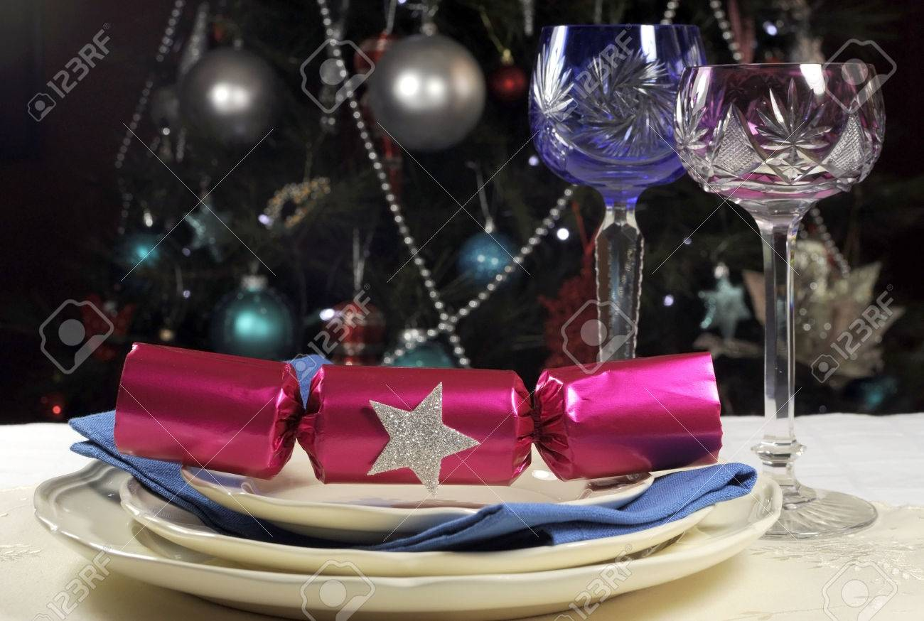 Beautiful Christmas table setting in front of Christmas Tree with pink and blue long stem & Beautiful Christmas Table Setting In Front Of Christmas Tree ...