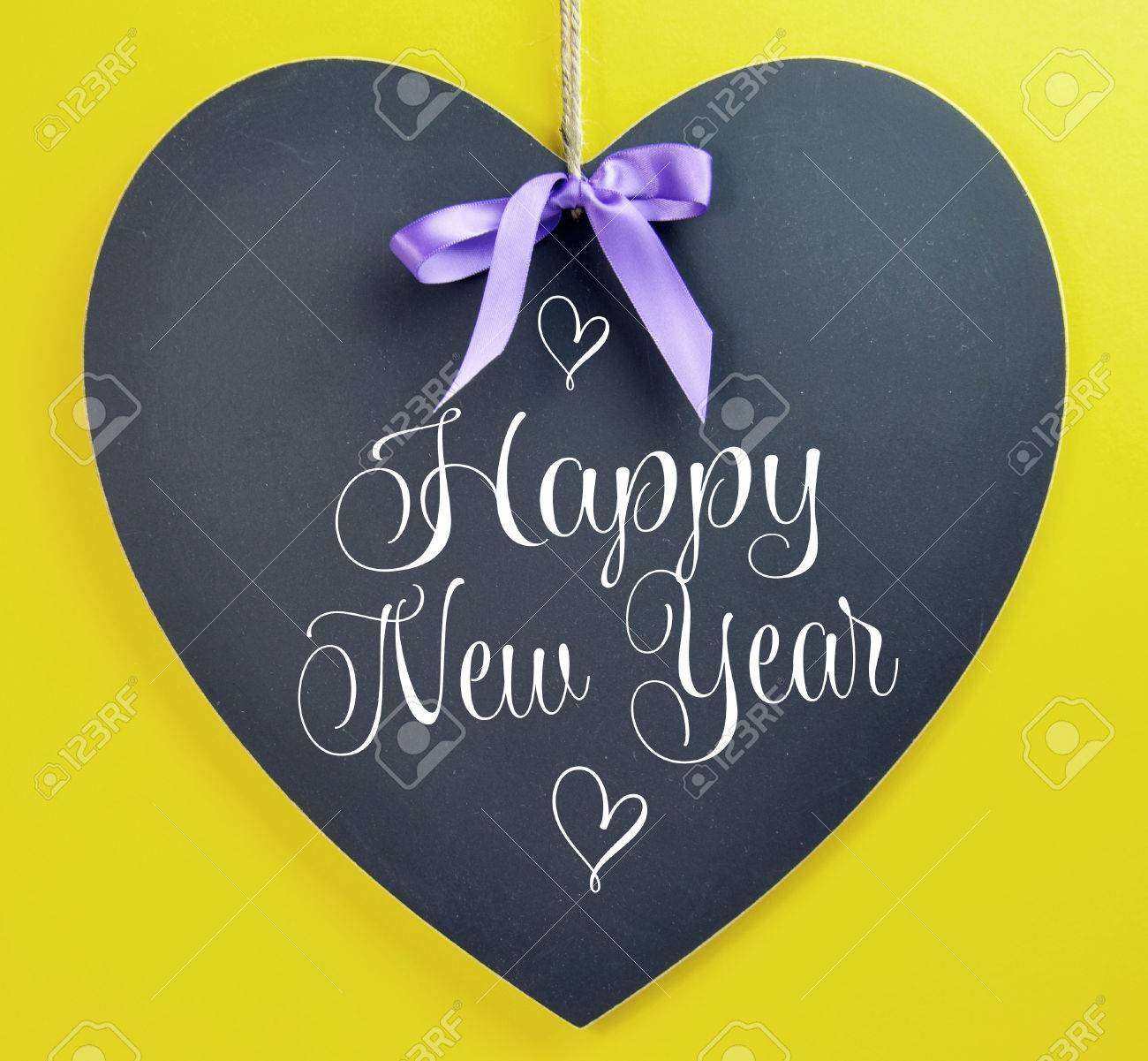 Happy New Year Message Greeting Written On Heart Shape Blackboard