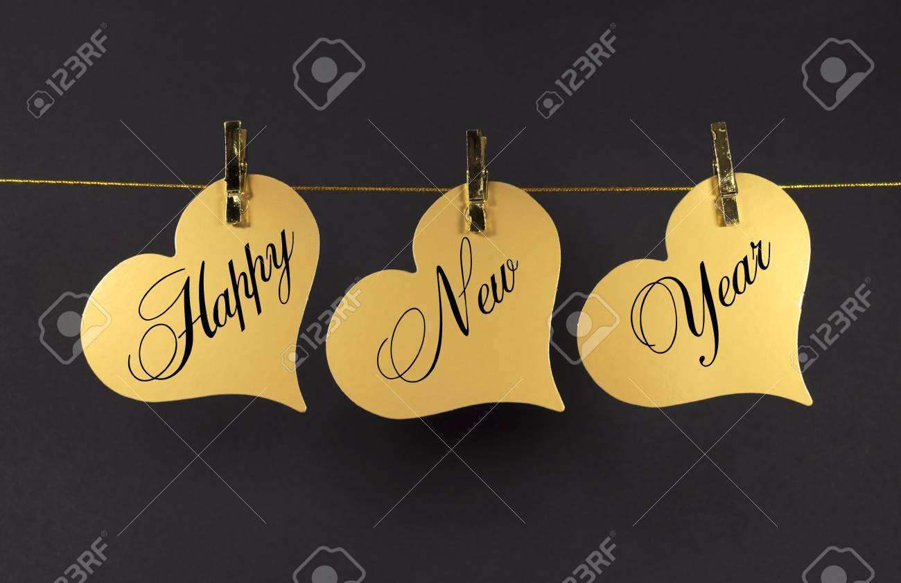 Happy New Year Message Greeting Text On Gold Hearts Hanging From