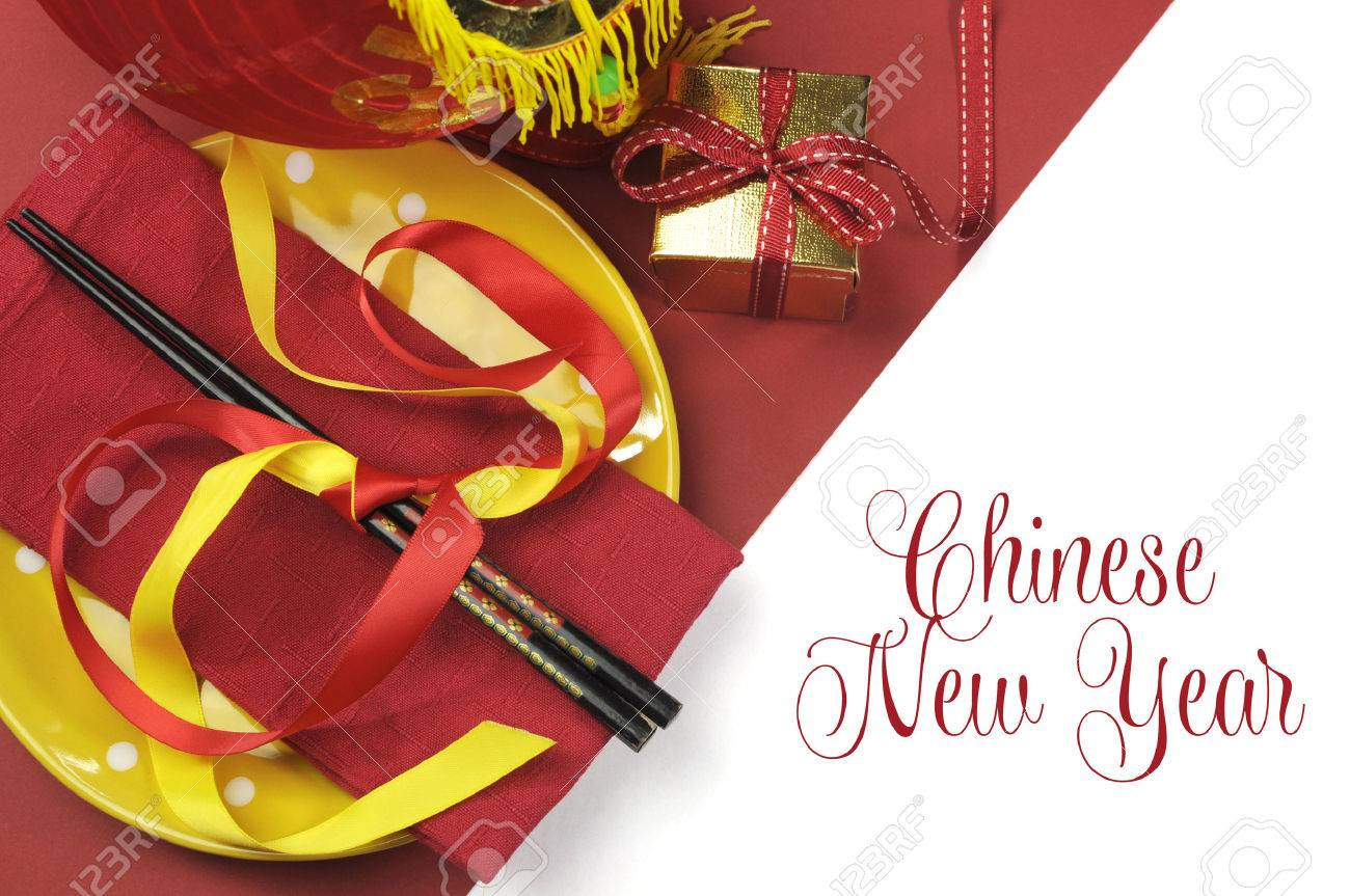 Happy chinese new year dining table place setting with red and happy chinese new year dining table place setting with red and gold decorations and chopsticks with kristyandbryce Gallery