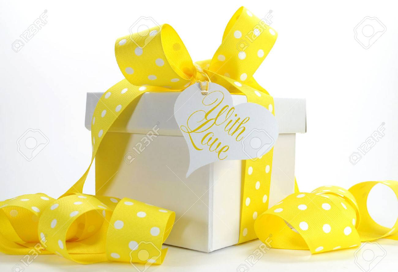 Yellow theme gift box with yellow polka dot ribbon and white stock stock photo yellow theme gift box with yellow polka dot ribbon and white copy space for easter birthday wedding baby or bridal shower present negle Image collections
