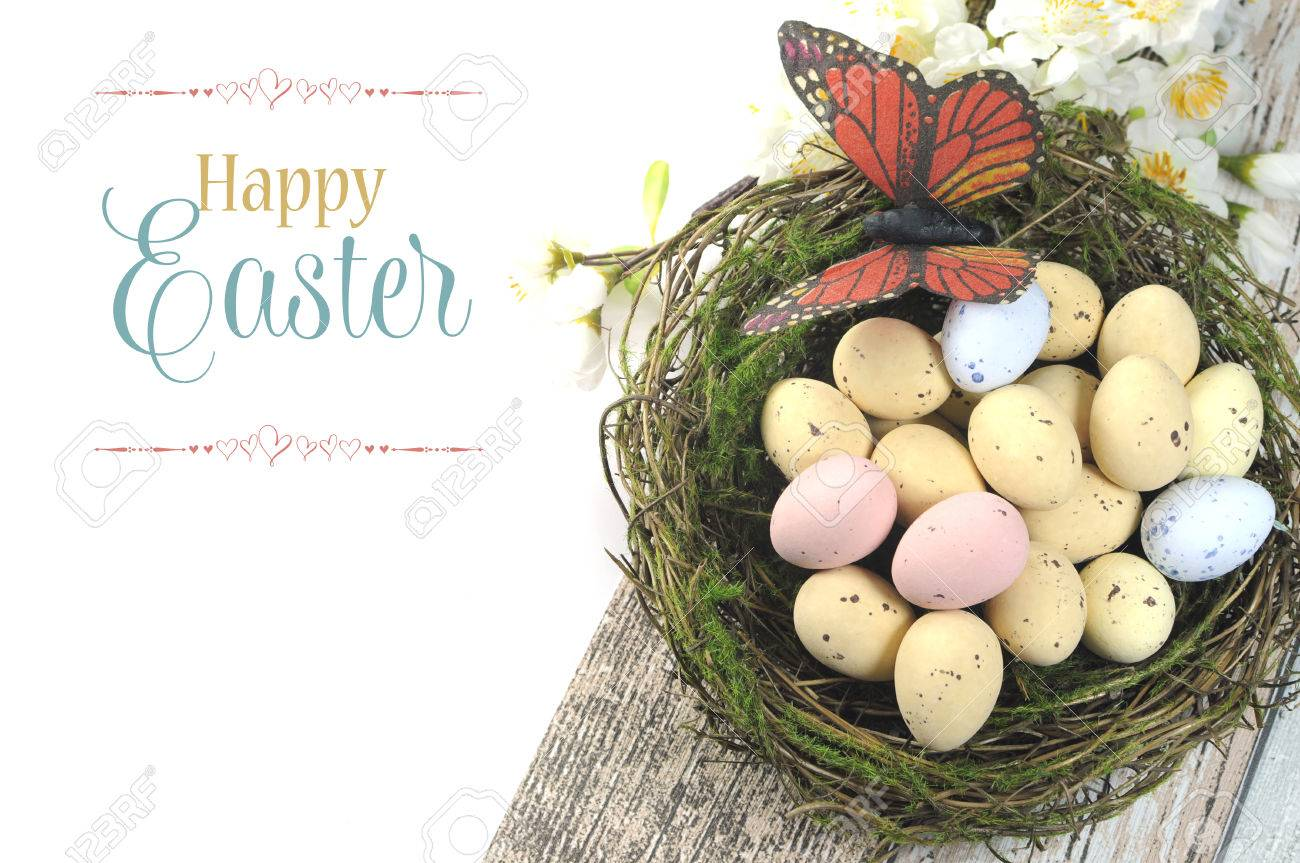 Happy Easter Shabby Chic Table With Speckled Birds Eggs And Butterfly In Nest Spring Blossoms