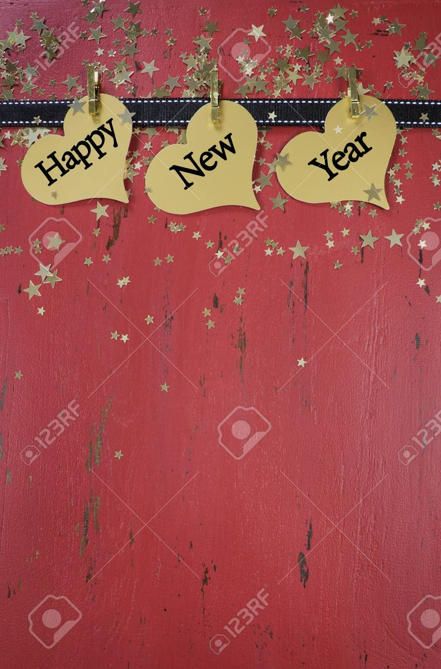 happy new year background with hanging hanging with sample text on red rustic distressed vintage wood