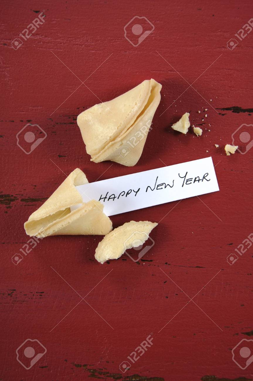 Happy new year message greeting inside chinese new year fortune happy new year message greeting inside chinese new year fortune cookie on red recycled wood background m4hsunfo Choice Image