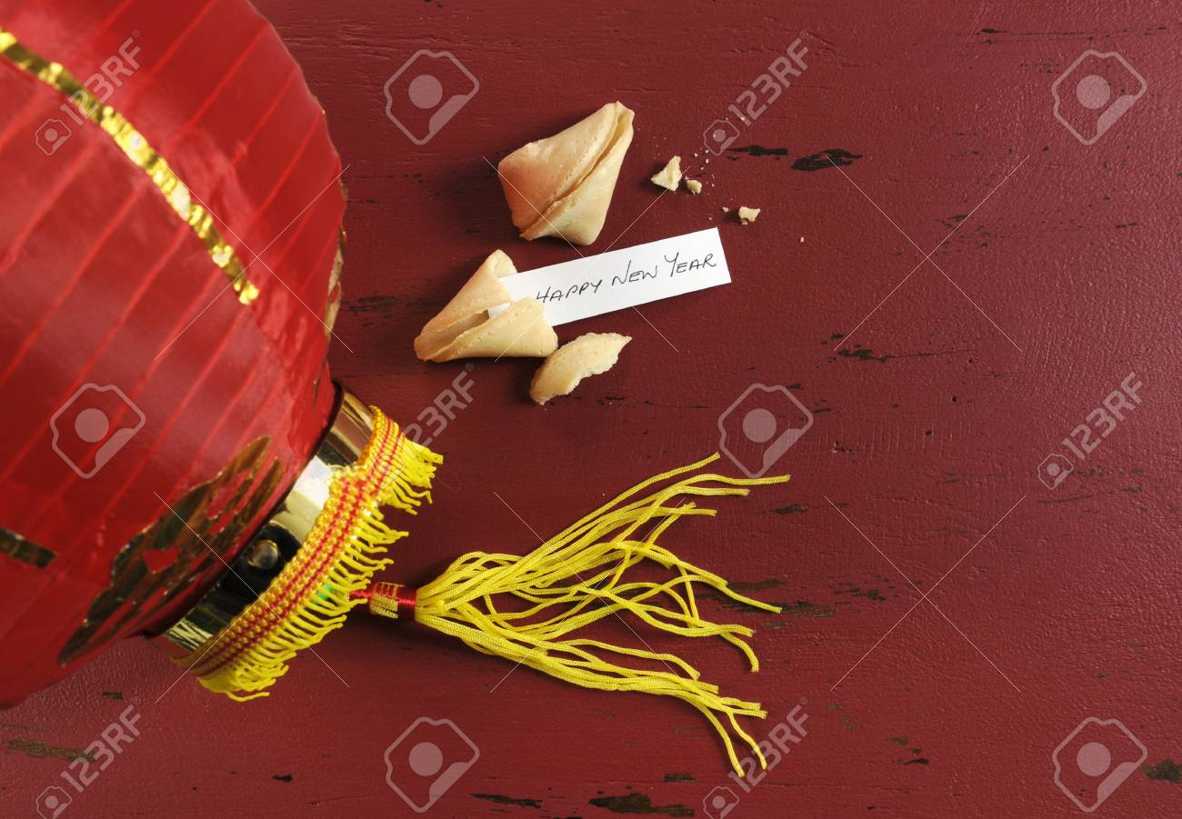 Happy new year message greeting inside chinese new year fortune happy new year message greeting inside chinese new year fortune cookie on red recycled wood background m4hsunfo