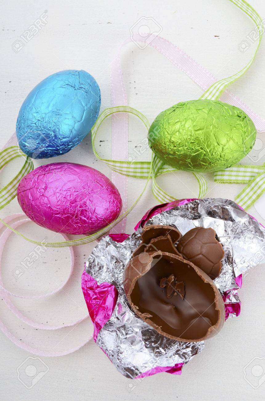 Happy Easter Pink Green And Blue Foil Wrapped Chocolate Eggs On Shabby Chic Vintage