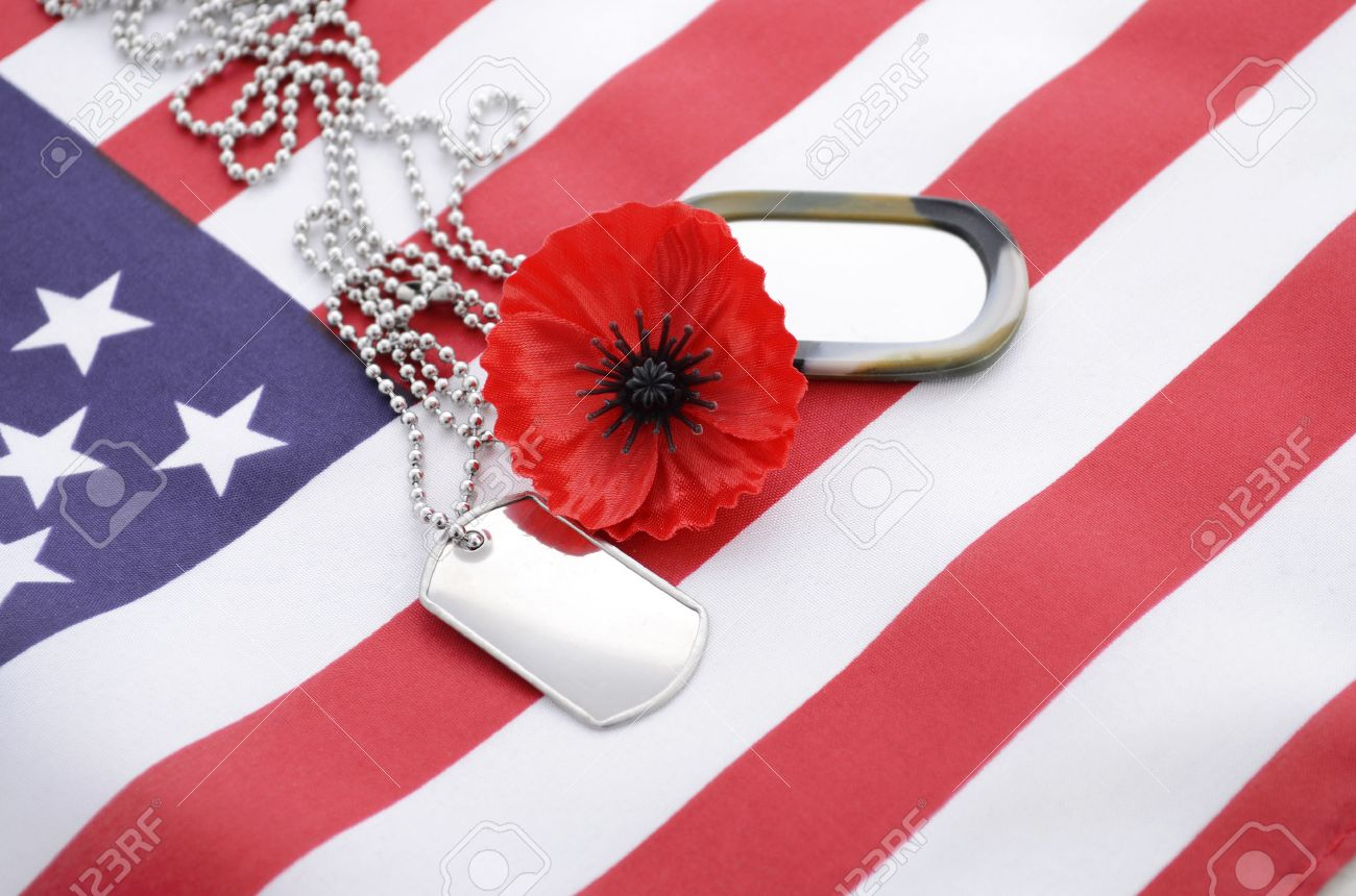 usa memorial day concept with dog tags and red remembrance poppy