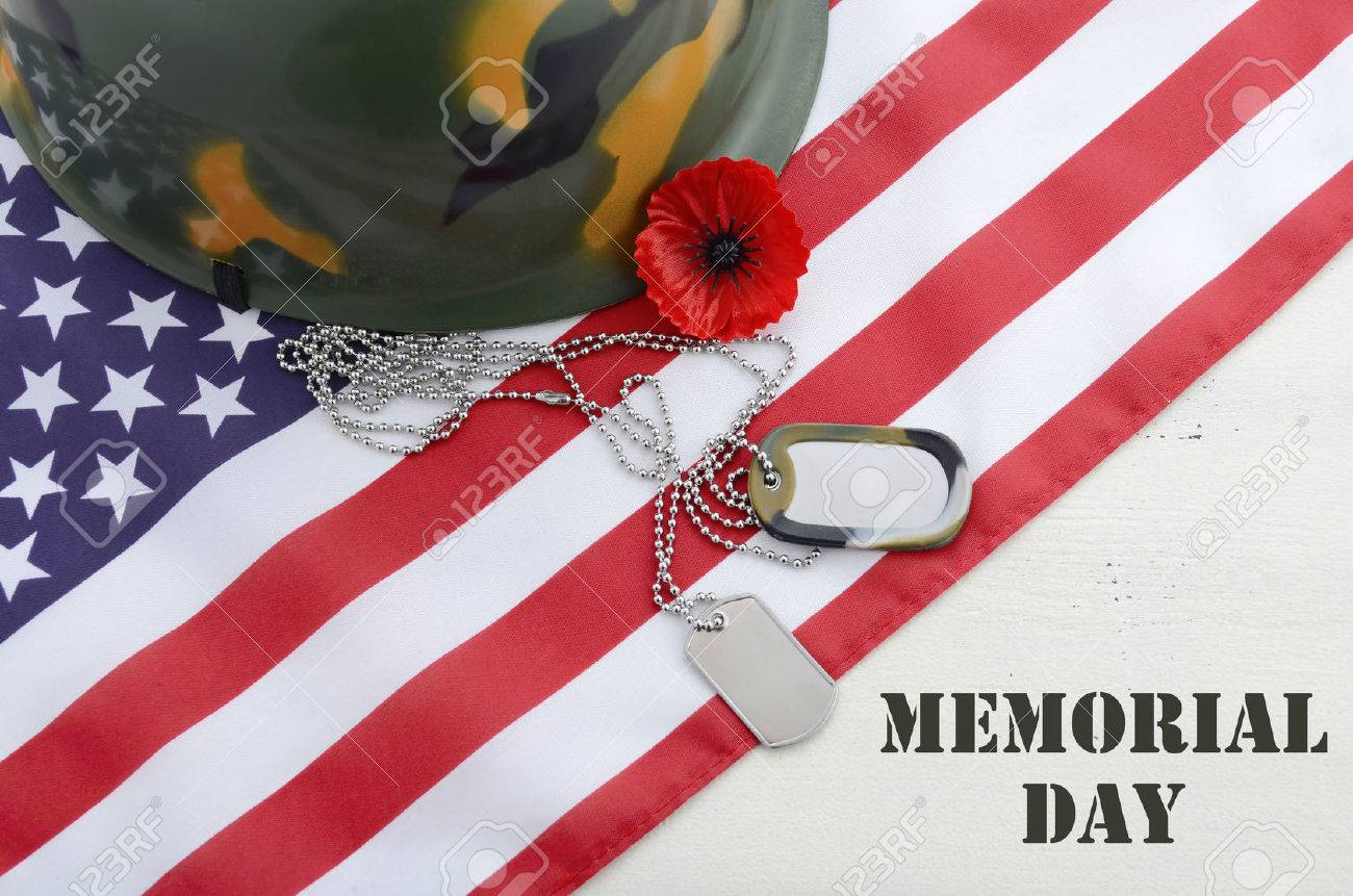 Usa memorial day concept with dog tags and red remembrance poppy stock photo usa memorial day concept with dog tags and red remembrance poppy on american stars and stripes flag on white vintage wood table with title publicscrutiny Gallery