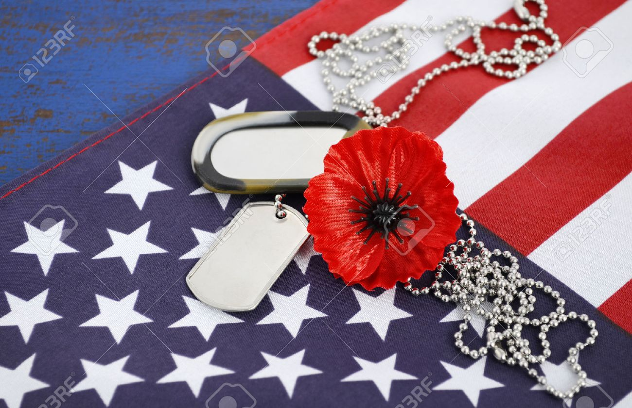 Usa memorial day concept with dog tags and red remembrance poppy usa memorial day concept with dog tags and red remembrance poppy on american stars and stripes publicscrutiny Image collections
