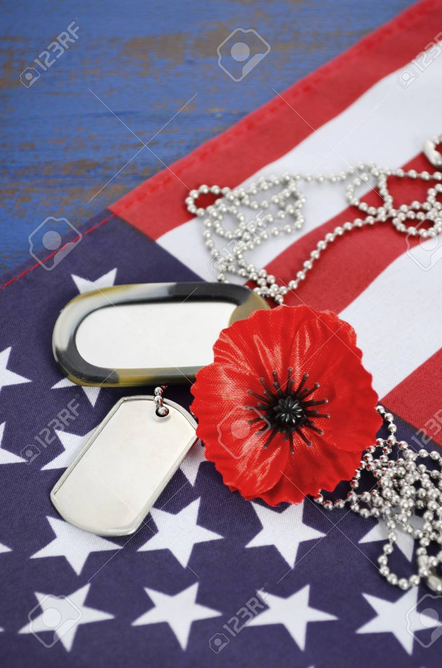 Usa memorial day concept with dog tags and red remembrance poppy stock photo usa memorial day concept with dog tags and red remembrance poppy on american stars and stripes flag on dark blue vintage wood table publicscrutiny Gallery