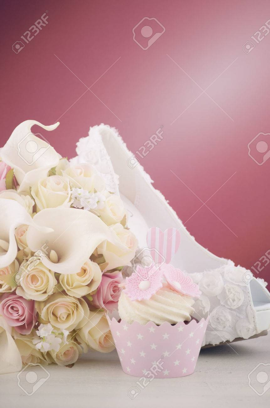 Wedding June Bride Concept With Cupcakes, White Shoes And Flowers ...