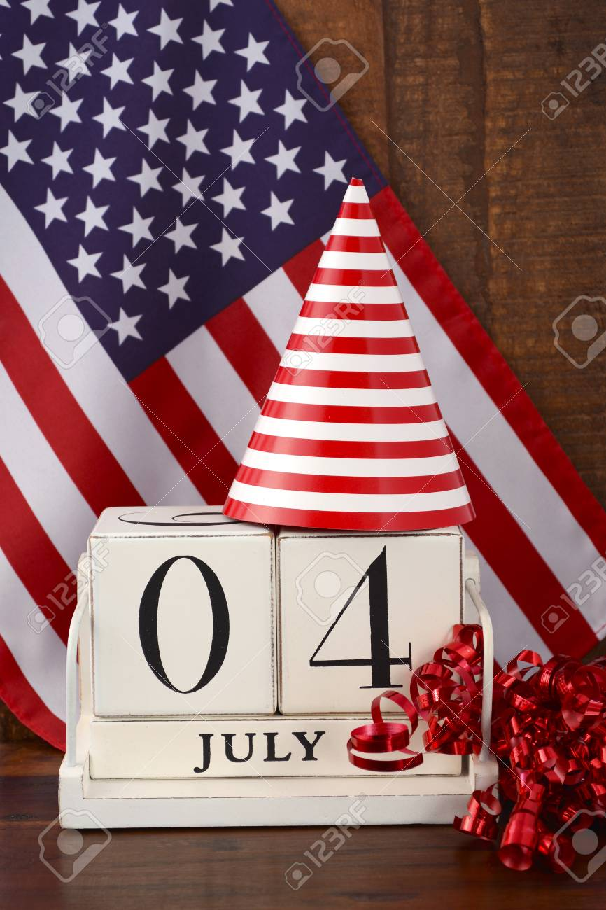 Fourth Of July Vintage Wood Calendar With Flag And Party Hat Stock