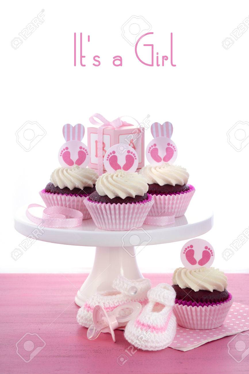 its a girl baby shower cupcakes with baby feet toppers and decorations on shabby chic pink - Decorating Baby Shower Cupcakes