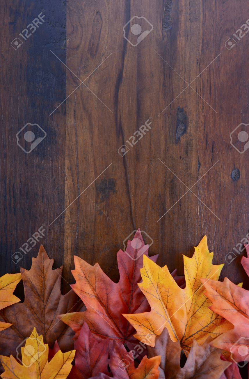 Autumn Fall Background For Thanksgiving Or Halloween With Leaves And Decorations On Rustic Wood Table