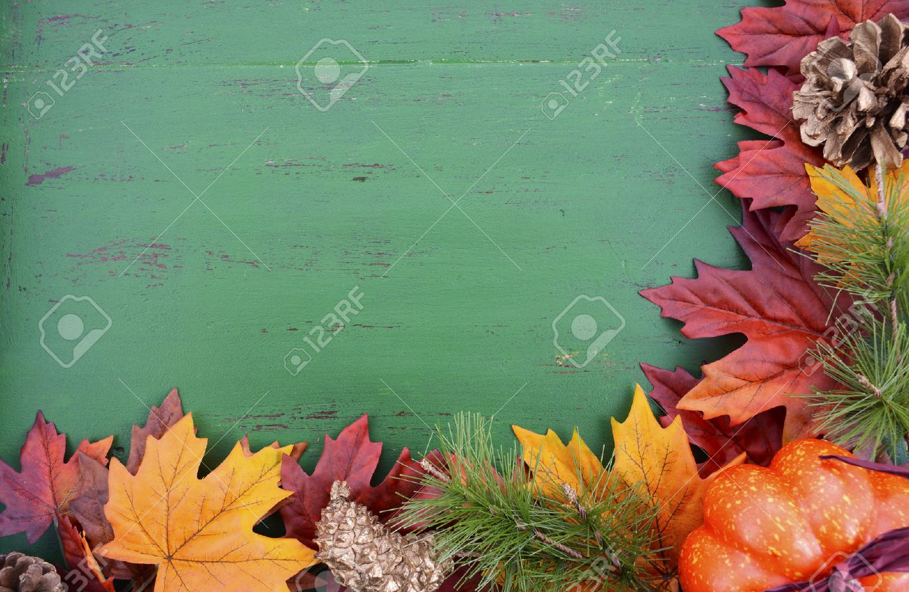 Autumn Fall Rustic Background On Green Vintage Distressed Wood With Leaves And Decorations Stock
